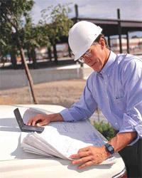 Qualifications of ICCA Members Foreman with Hard Hat Studying Blueprints